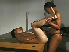 Black Chick Fucks White Guy With Strapon