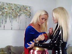 Super Girl Vs Catwoman In Latex Busty Babes Fuck Big Strapon