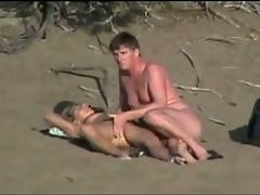 Nude Beach Couples Competing For Voyeurs Attention