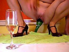 Slim Woman Shoves Full Size Wine Bottle In Eager Pussy